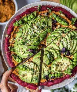 """Beet """"Falafel"""" Pizza Crust with Sun Dried Tomato Hummus and Avocado"""