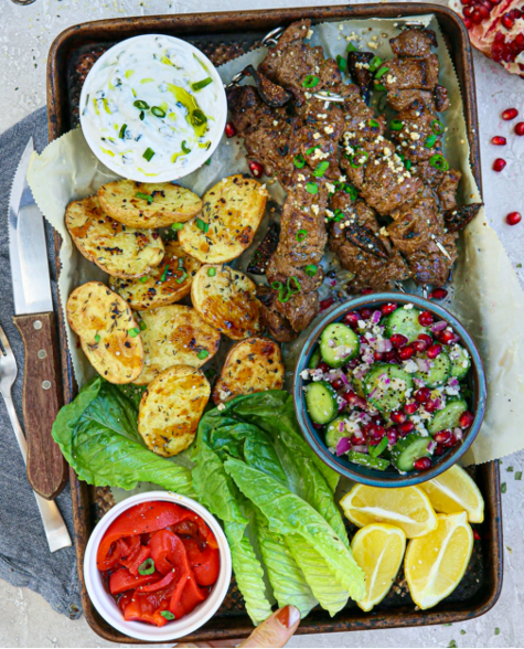 Rosemary, Mustard and Fig Lamb Kabobs with Cucumber, Pomegranate and Feta Salad